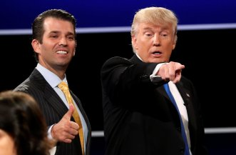 FILE PHOTO: Donald Trump Jr. gives a thumbs up beside his father Donald Trump after presidential debate in Hempstead, New York